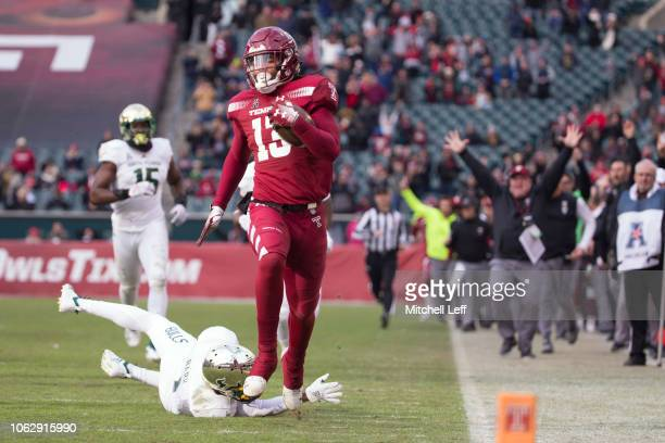 Isaiah Wright of the Temple Owls runs past Chris Barr of the South Florida Bulls to score on a touchdown on a punt return in the fourth quarter at...