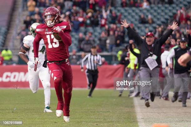 Isaiah Wright of the Temple Owls runs past Tony Grier Jr #44 of the South Florida Bulls to score on a touchdown on a punt return in the fourth...