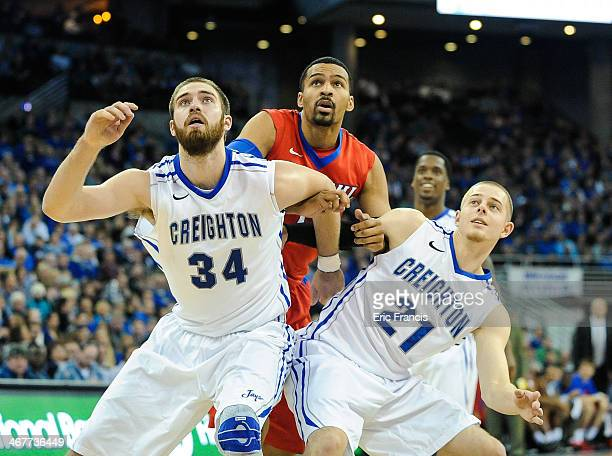 Isaiah Zierden and Ethan Wragge of the Creighton Bluejays box out DeJuan Marrero of the DePaul Blue Demons during their game at CenturyLink Center on...