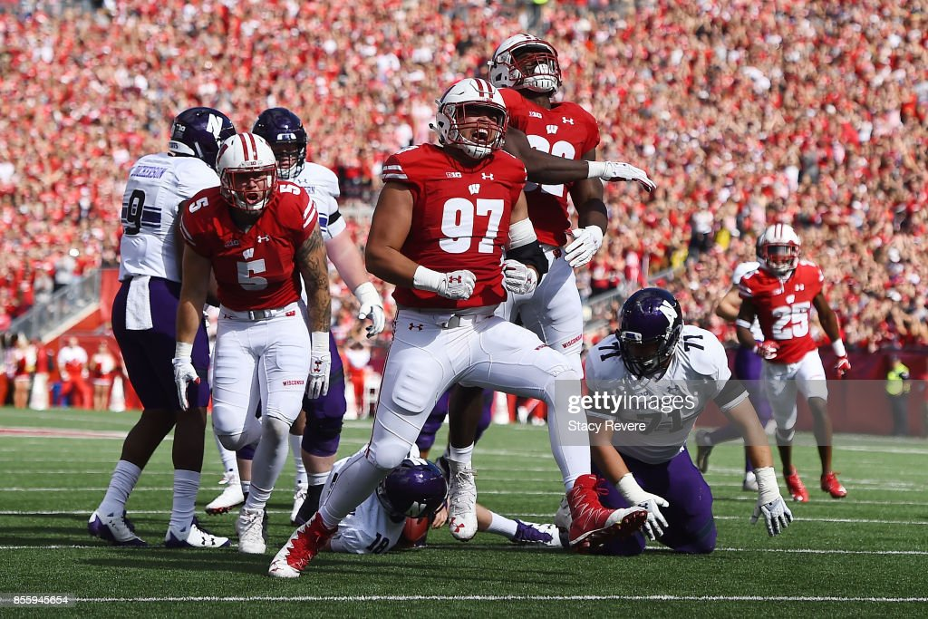 Isaiahh Loudermilk #97 of the Wisconsin Badgers reacts to a sack against the Northwestern Wildcats during the first quarter of a game at Camp Randall Stadium on September 30, 2017 in Madison, Wisconsin.