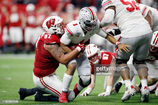 Isaiahh Loudermilk of the Wisconsin Badgers sacks Justin Fields of the Ohio State Buckeyes in the second quarter of the Big Ten Football Championship...