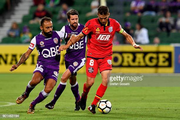 Isaias of Adelaide contests for the ball against Diego Castro of the Glory during the round 14 ALeague match between the Perth Glory and Adelaide...