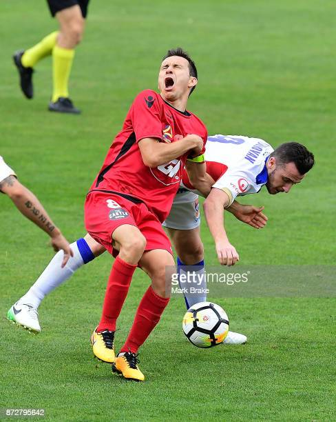 Isaias of Adelaide cops an elbow from Roy O'Donavan of Newcastle during the round six ALeague match between Adelaide United and the Newcastle Jets at...