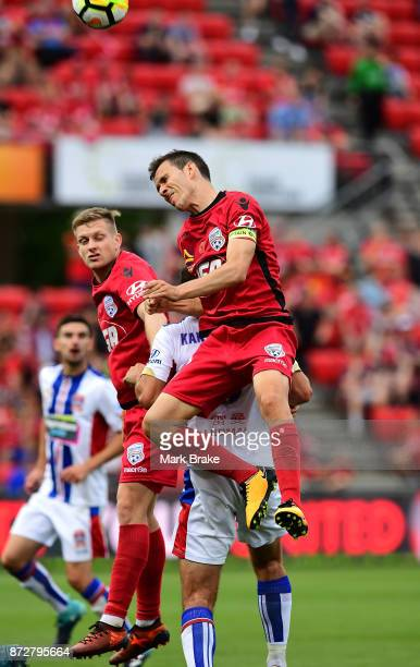 Isaias of Adelaide heads a ball during the round six ALeague match between Adelaide United and the Newcastle Jets at Coopers Stadium on November 11...