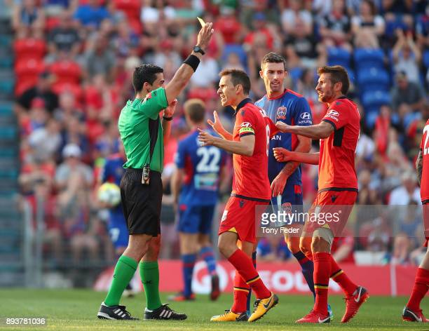Isaias of Adelaide receives a yellow card during the round 11 ALeague match between the Newcastle Jets and the Adelaide United at McDonald Jones...