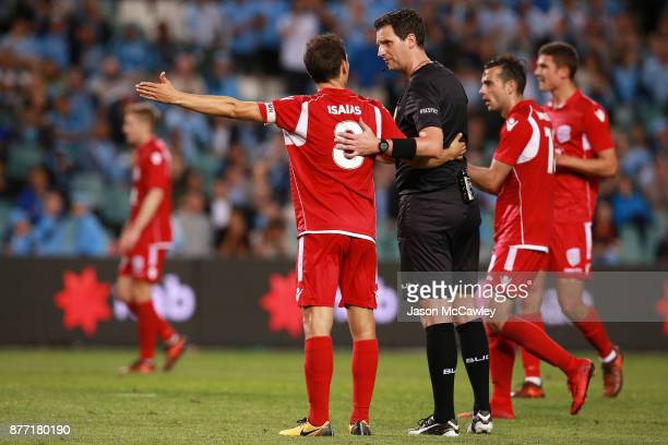 Isaias of Adelaide speaks to Referee Kris GriffithsJones during the FFA Cup Final match between Sydney FC and Adelaide United at Allianz Stadium on...