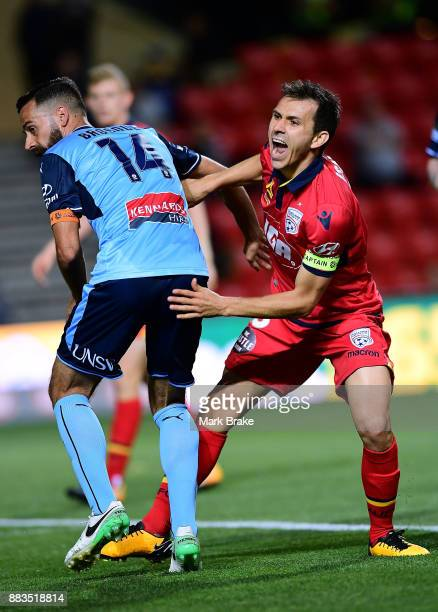 Isaias of Adelaide United and Alex Brosque of Sydney FC during the round nine ALeague match between the Adelaide 36ers and the Sydney Kings at...