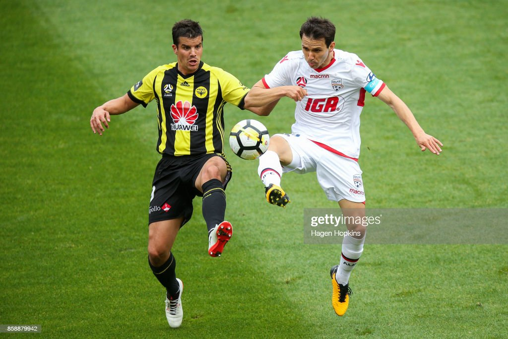 Isaias of Adelaide United and Andrija Kaludjerovic of the Phoenix compete for the ball during the round one A-League match between Wellington Phoenix and Adelaide United at Westpac Stadium on October 8, 2017 in Wellington, New Zealand.