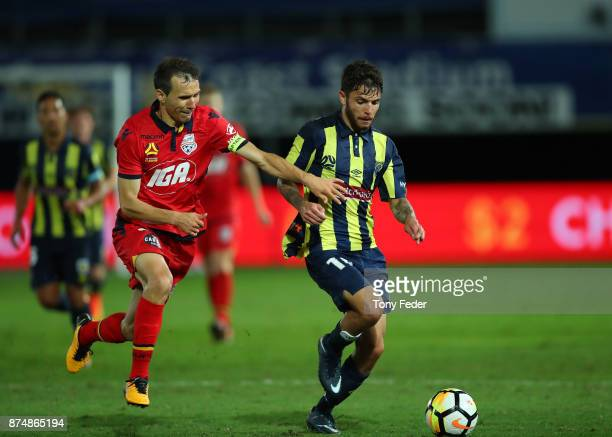 Isaias of Adelaide United contests the ball with Daniel De Silva of the Mariners during the round seven ALeague match between the Central Coast...