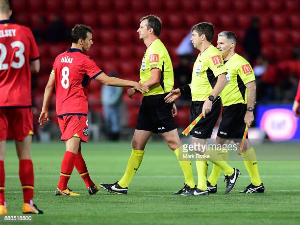 Isaias of Adelaide United shakes hands withh referee Peter Green during the round nine ALeague match between the Adelaide 36ers and the Sydney Kings...