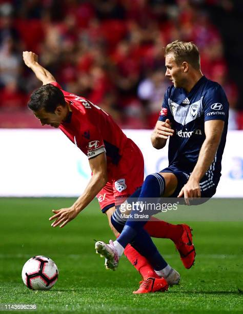 Isaias of Adelaide United tackled by Ola Toivonen of the Victory during the round 26 ALeague match between Adelaide United and Melbourne Victory at...