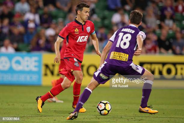 Isaias of the Reds looks to pass the ball during the round five ALeague match between the Perth Glory and Adelaide United at nib Stadium on November...
