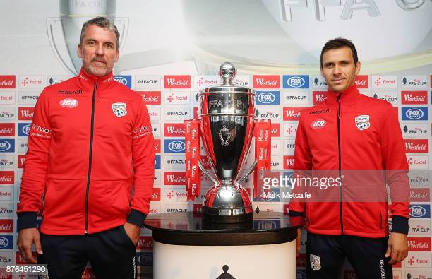 Isaias Sanchez of Adelaide United poses with head coach Marco Kurz during a press conference at Allianz Stadium on November 20 2017 ahead of...