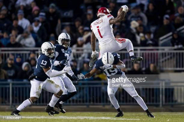 Isaih Pacheco of the Rutgers Scarlet Knights hurdles Trent Gordon of the Penn State Nittany Lions in the first half at Beaver Stadium on November 30...