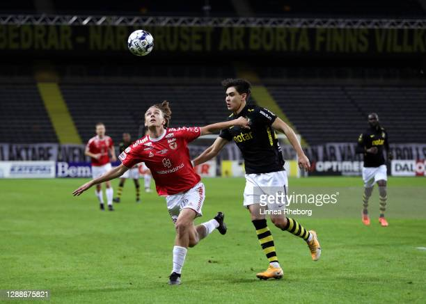Isak Magnusson of Kalmar FF battles for possession with Eric Kahl of AIK during the Allsvenskan match between AIK and Kalmar FF at Friends arena on...