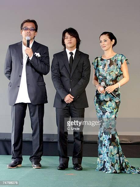 Isamu Nakae director Yuya Yagira and Mari Natsuki at the 2006 Cannes Film Festival Fuji Television Party at Majestic Beach in Cannes