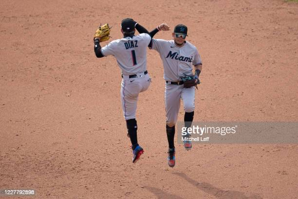 Isan Diaz and Miguel Rojas of the Miami Marlins celebrate their win against the Philadelphia Phillies at Citizens Bank Park on July 26, 2020 in...