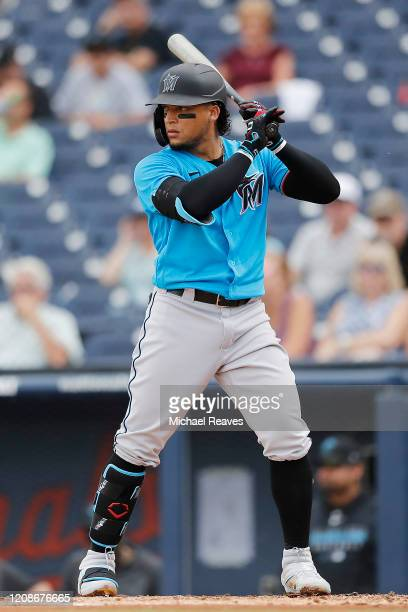 Isan Diaz of the Miami Marlins at bat against the Houston Astros during a Grapefruit League spring training game at FITTEAM Ballpark of The Palm...