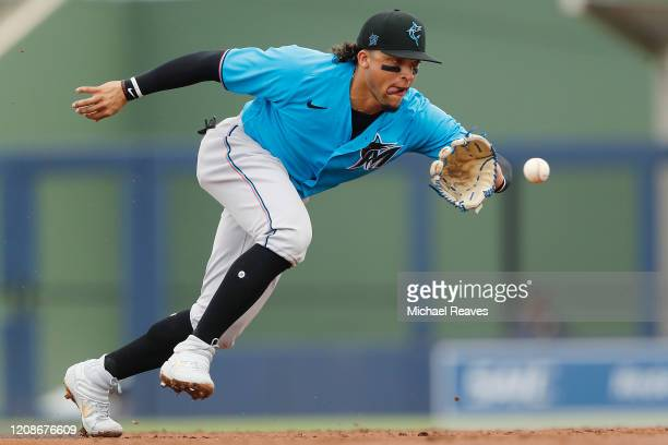 Isan Diaz of the Miami Marlins fields a ground ball against the Houston Astros during a Grapefruit League spring training game at FITTEAM Ballpark of...
