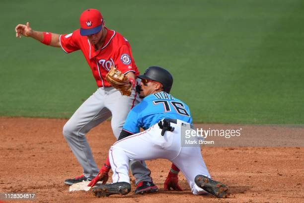 Isan Diaz of the Miami Marlins steals a base in the sixth inning against the Washington Nationals at Roger Dean Stadium on March 1 2019 in Jupiter...