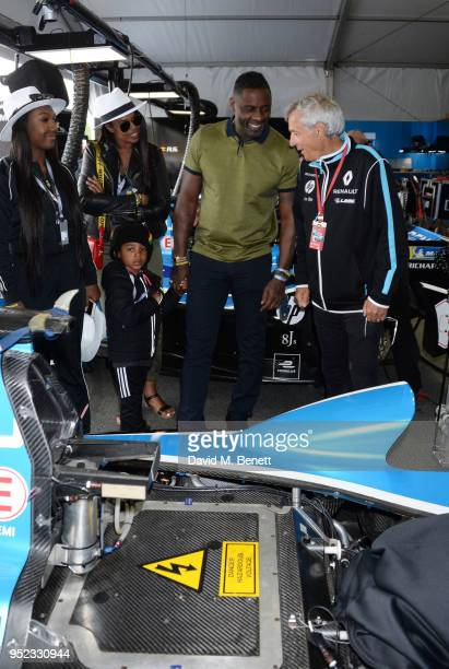 Isan Elba Winston Elba Sabrina Dhowre and Idris Elba speak with Renault senior team manager JeanPaul Driot at the ABB FIA Formula E Qatar Airways...