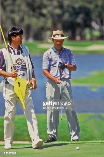 Isao Aoki reads a putt during the PGA Senior Championship Florida 1996