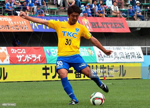 Isao Homna of Tochigi SC scores his team's second goal during the JLeague second division match between Tochigi SC and Mito Holly Hock at Tochigi...