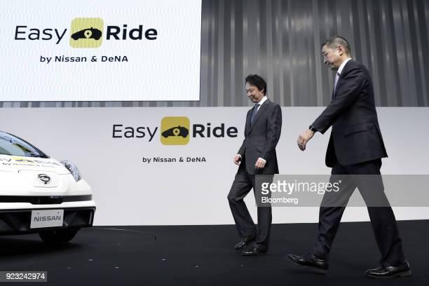 Isao Moriyasu president and chief executive officer of DeNA Co left and Hiroto Saikawa president and chief executive officer of Nissan Motor Co...