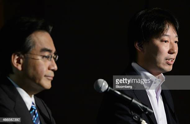 Isao Moriyasu president and chief executive officer of DeNA Co right speaks while Satoru Iwata president of Nintendo Co listens during a joint news...