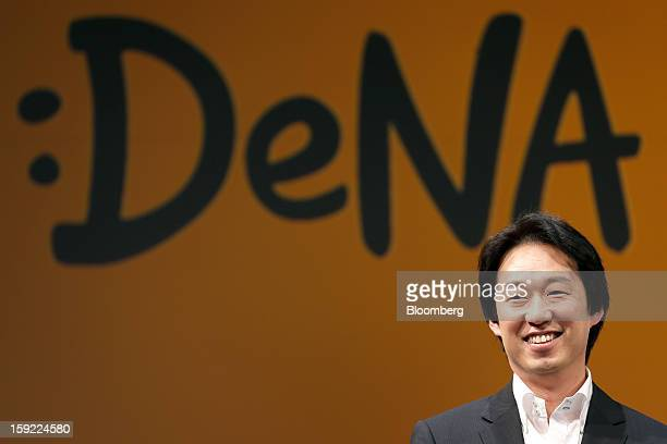 Isao Moriyasu president of DeNA Co smiles in front of the company's new logo as he attends a news conference in Tokyo Japan on Thursday Jan 10 2013...