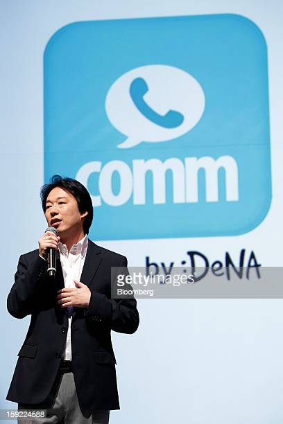 Isao Moriyasu president of DeNA Co speaks in front of the logo for Comm the company's free calling app during a news conference in Tokyo Japan on...