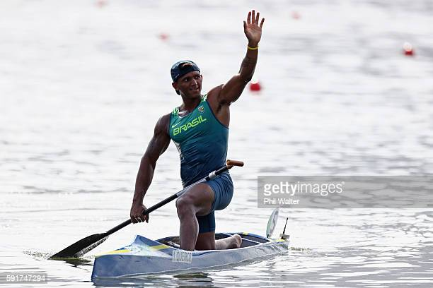 Isaquias Queiroz dos Santos of Brazil celebrates after winning bronze in the Men's Canoe Single 200m Final at the Lagoa Stadium on Day 13 of the 2016...