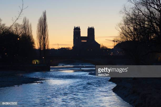 isar river and st. maximilian church taken against bright evening sky, munich, bavaria, germany, europe - fiume isar foto e immagini stock
