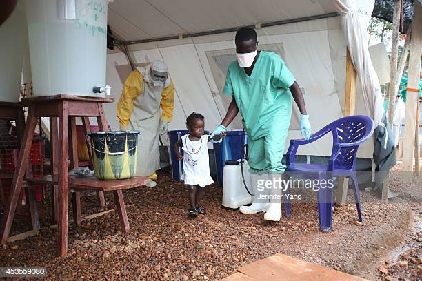 Isata a 22monthold is the youngest patient to be discharged from the Ebola treatment centre in Kailahun district Sierra Leone