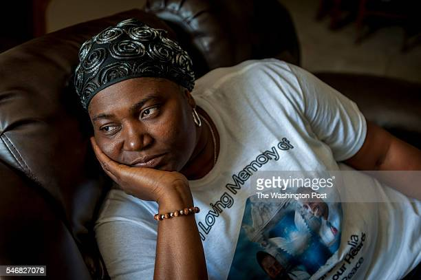 Isatu Salia whose husband Dr Martin Salia was killed in Sierra Leone from Ebola relaxes at home with her sons Hinwaii Sakatty Salia 14 and Maada...