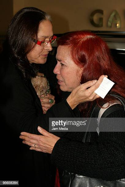 Isaura Espinoza and a relative of Blanca attend Blanca Sanchez's funeral at Funerarua Gayosso on January 8 2010 in Mexico City Mexico