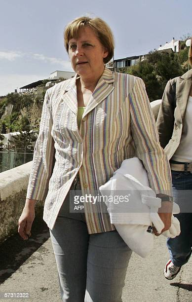 CORRECTION NAME Germany's chancellor Angela Merkel walks in the little streets of Sant'Angelo 11 Avril 2006 as she spends two weeks of holidays in...