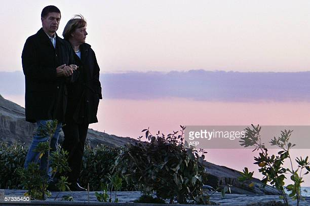 German Chancellor Angela Merkel and her husband Joachim Sauer watch the sun set in Sant'Angelo of Ischia 13 Avril 2006 where Merkel is spending a...