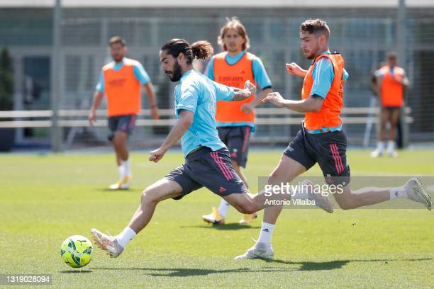 Isco Alarcón and Federico Valverde of Real Madrid in action during a training session at Valdebebas training ground on May 20, 2021 in Madrid, Spain.
