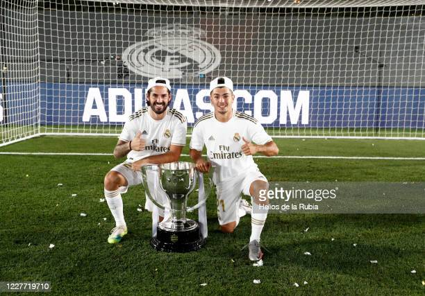 Isco Alarcon and Brahim Diaz player of Real Madrid poses with the La Liga trophy after Madrid secure the La Liga title during the Liga match between...