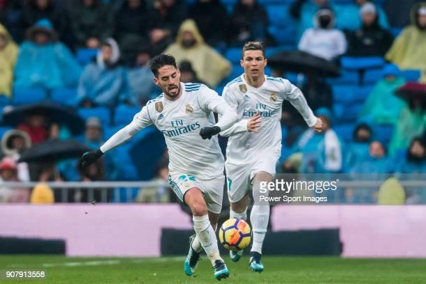 Isco Alarcon and Cristiano Ronaldo of Real Madrid run for the ball during the La Liga 201718 match between Real Madrid and Villarreal CF at Santiago...