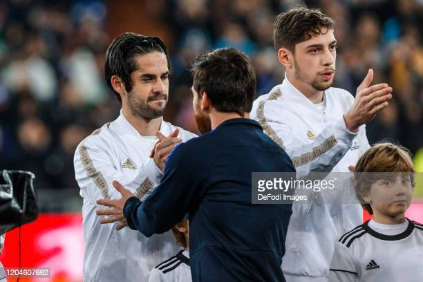 Isco Alarcon and Federico Valverde of Real Madrid Lionel Messi of FC Barcelona gestures prior to the Liga match between Real Madrid CF and FC...