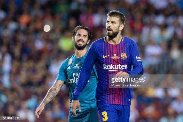 Isco Alarcon of Real Madrid and Gerard Pique Bernabeu of FC Barcelona during the Supercopa de Espana Final 1st Leg match between FC Barcelona and...