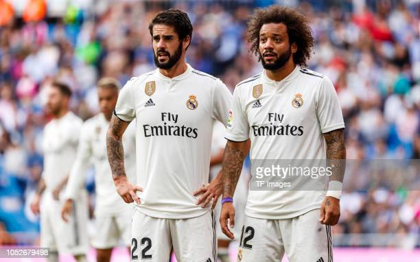 Isco Alarcon of Real Madrid and Marcelo of Real Madrid look on during the La Liga match between Real Madrid CF and Levante UD at Estadio Santiago...