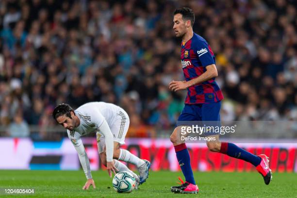 Isco Alarcon of Real Madrid and Sergio Busquets of FC Barcelona battle for the ball during the Liga match between Real Madrid CF and FC Barcelona at...