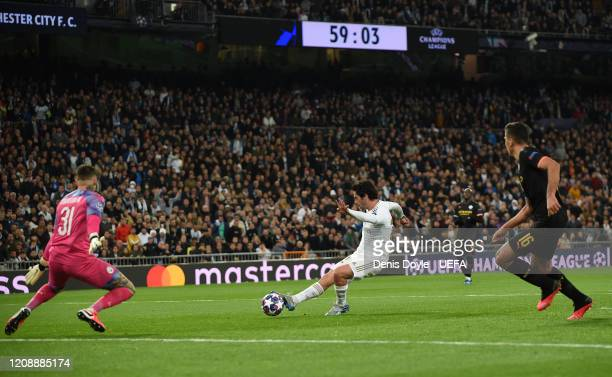 Isco Alarcon of Real Madrid beats Ederson of Manchester City to score his team's opening goal during the UEFA Champions League round of 16 first leg...