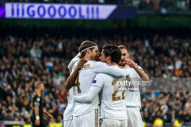 Isco Alarcon of Real Madrid celebrates after scoring his team`s first goal with team mates during the UEFA Champions League round of 16 first leg...