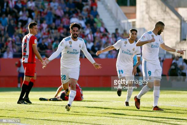 Isco Alarcon of Real Madrid celebrates after scoring the opening goal during the La Liga match between Girona and Real Madrid at Estadi de Montilivi...