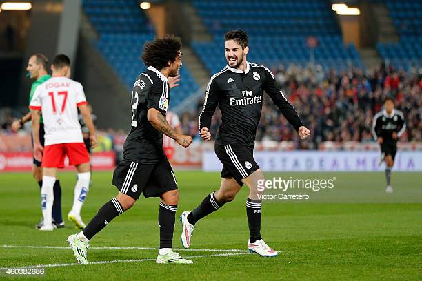 Isco Alarcon of Real Madrid celebrates with his teammate Marcelo Vieira after scoring the opening goal during the La Liga match between UD Almeria...