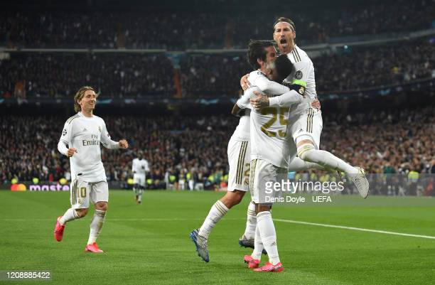 Isco Alarcon of Real Madrid celebrates with Sewrgio Ramos after scoring his team's opening goal during the UEFA Champions League round of 16 first...
